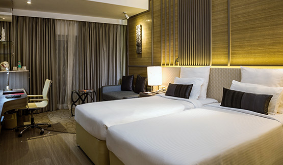 Two Single Beds of Deluxe Room - The Resort In Mumbai